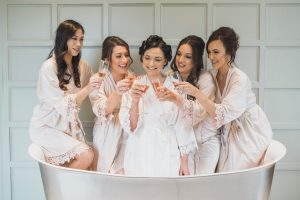 bridal party in bath tub Elmore court wedding photographer
