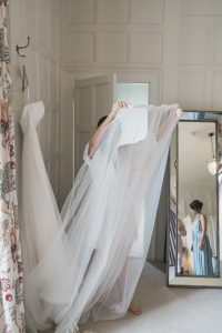 bridesmaid carrying veil Elmore court wedding photography