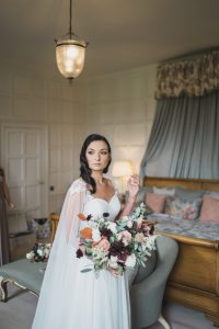 bride holding the rose shed wedding bouquet Elmore court wedding photographer