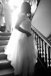 bride walking down staircase Elmore court wedding photography
