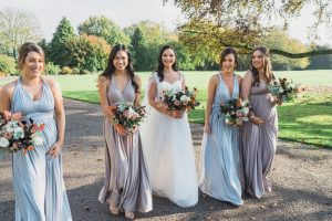 bride and bridesmaids walking at Elmore court wedding