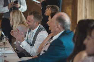 groom laughing Elmore court wedding photographer