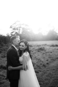 groom kissing bride Elmore court photographers