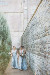 bridesmaids walking to gillyflower Elmore court wedding photographer
