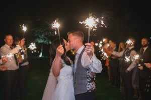 wedding couple holding sparklers at elmore court wedding