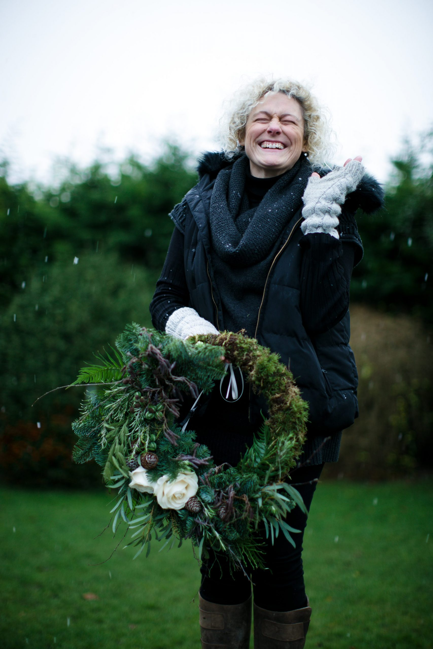 wild and co florist laughing with snow