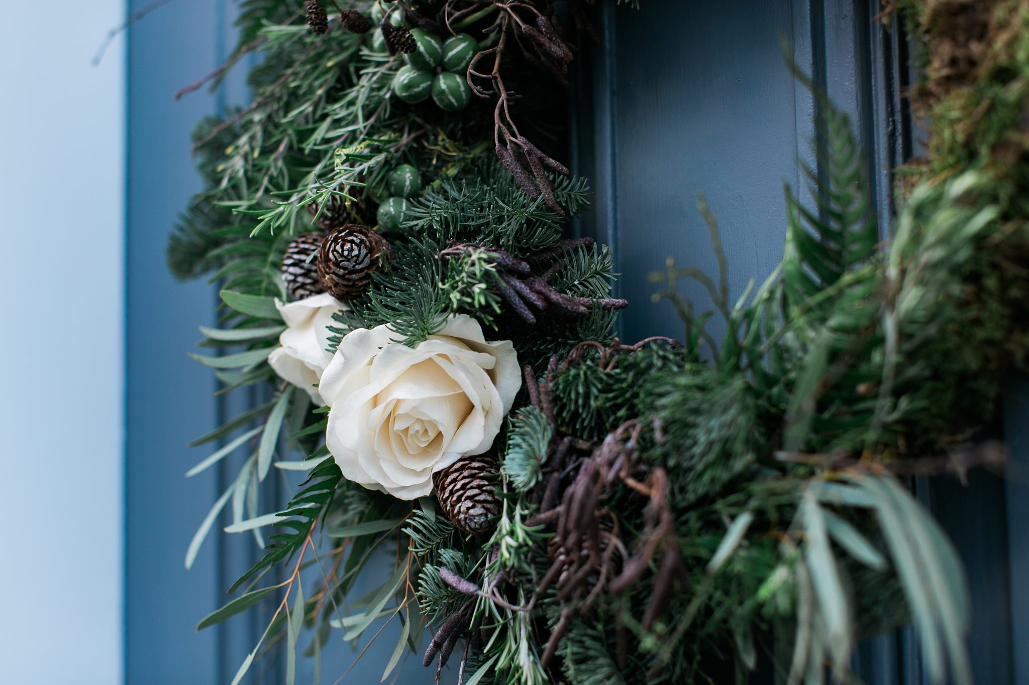 roses on christmas wreath wild and co