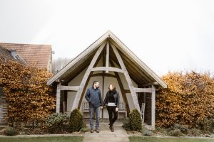 couple outside Kingscote Barn wedding venue