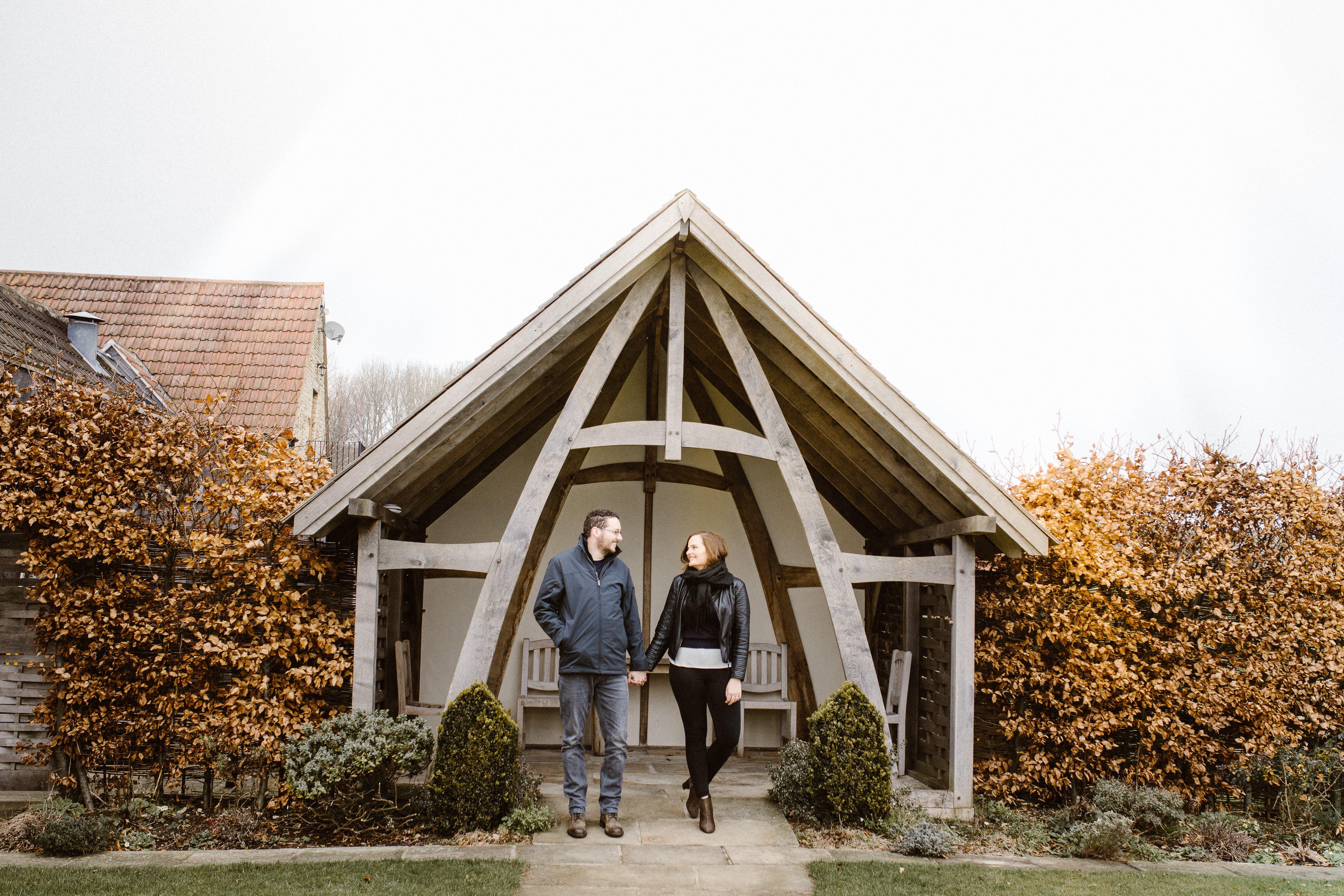 couple outside Kingscote Barn wedding venue