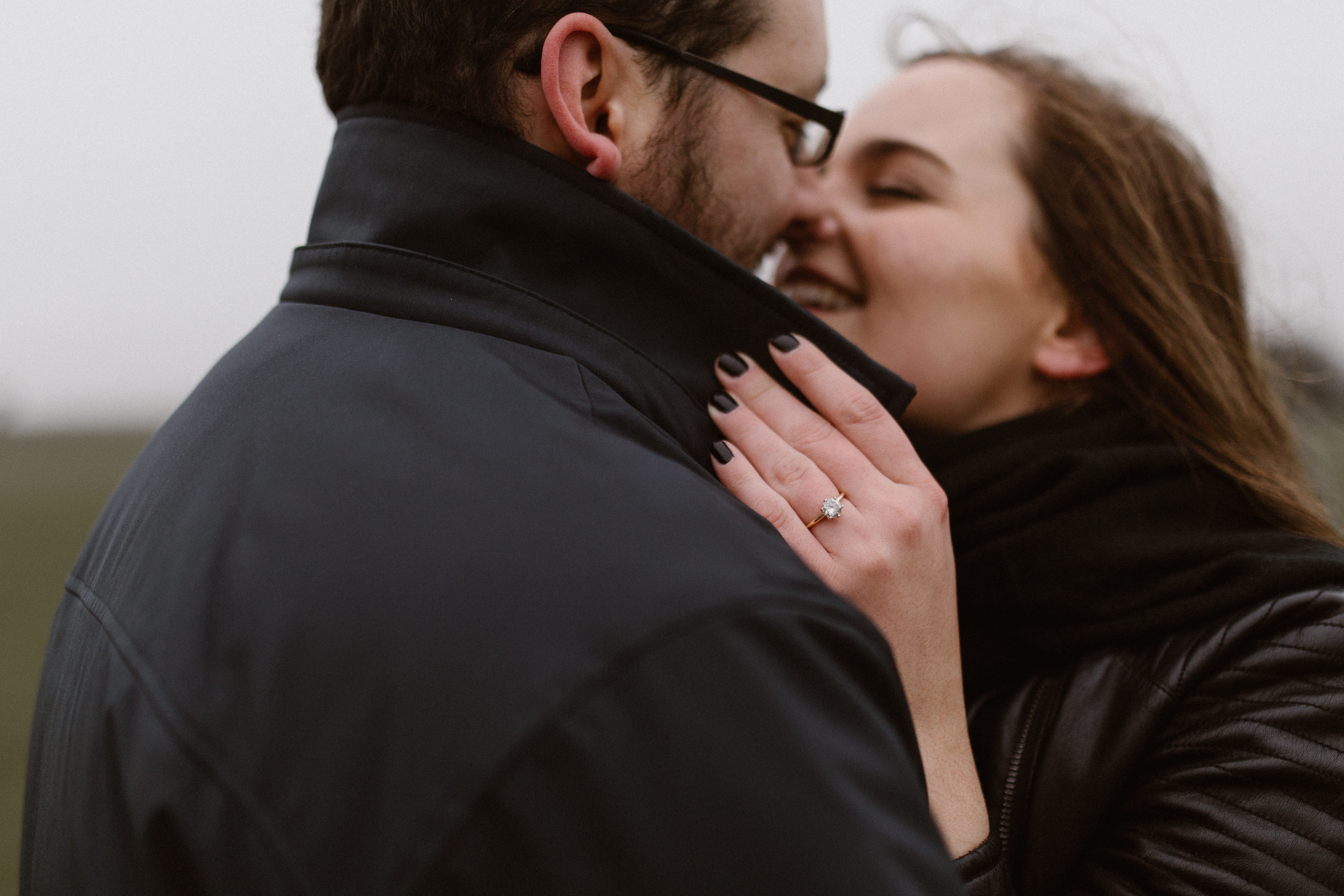 girl kissing boy on cold day at engagement shoot with gloucestershire wedding photographer