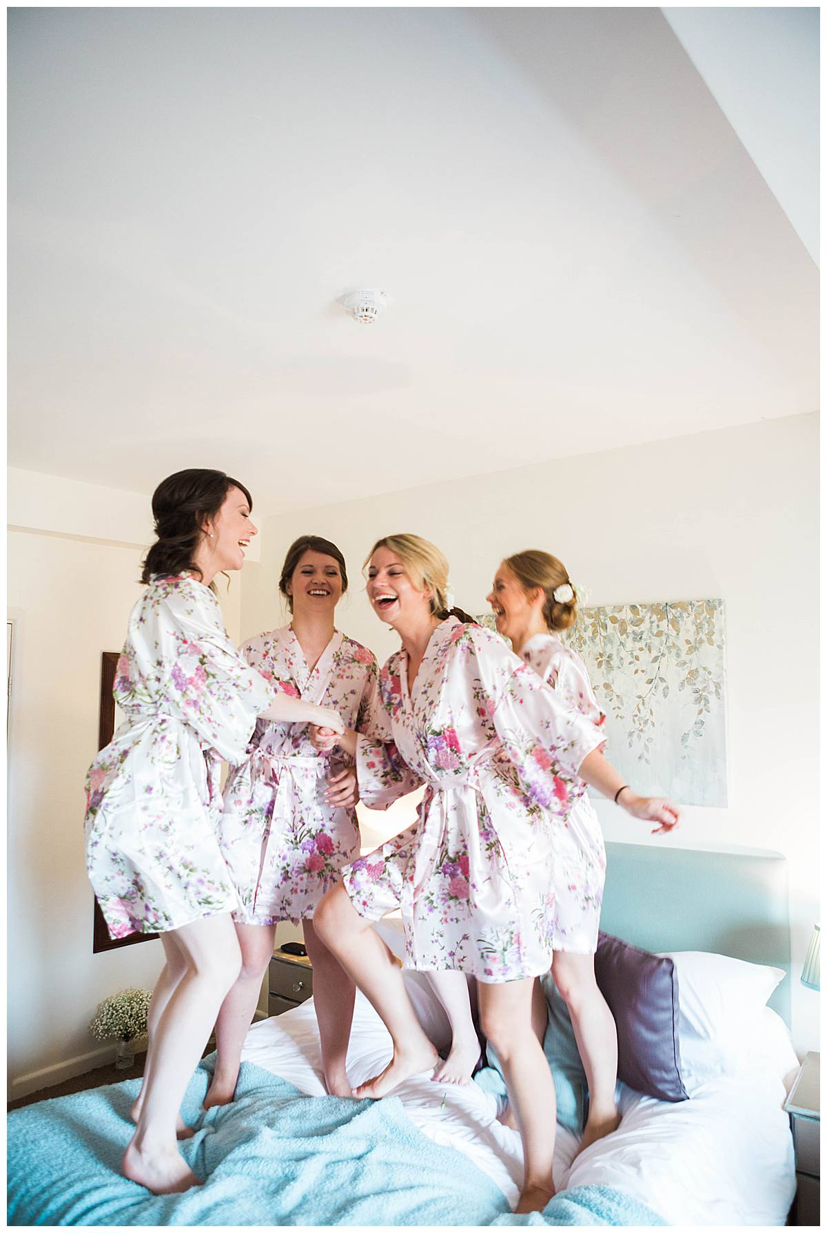 bridal party jumping on bed great tythe barn wedding photographers