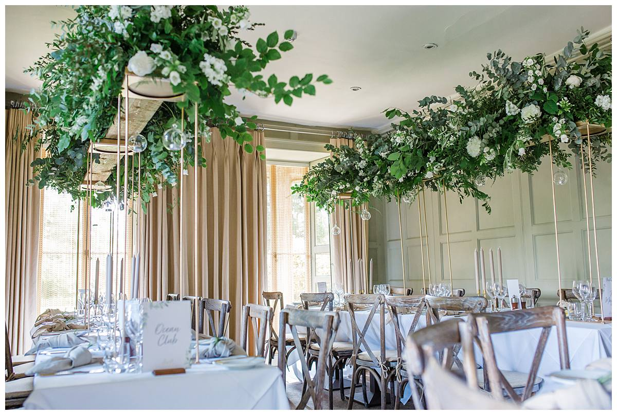 wedding breakfast inside Barnsley House designed by the rose shed photographed by gloucestershire wedding photographer