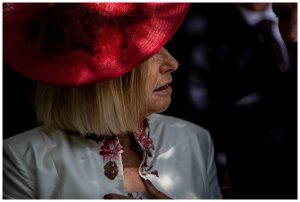 red hat on woman Barnsley House wedding photography