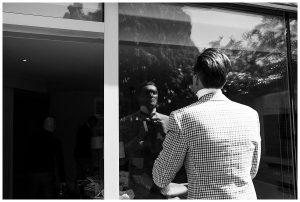 fixing tie Barnsley house wedding photography