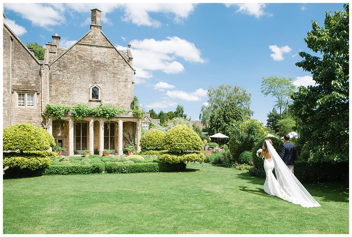 Barnsley House couple walking away from gloucestershire wedding photographer