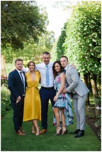 guests posing for gloucestershire wedding photographer at Barnsley House