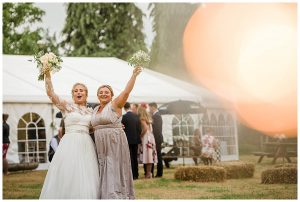 bride and bridesmaid excited Gloucestershire wedding photographers