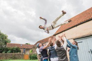 groomsmen throwing groom in the air bristol wedding photographers