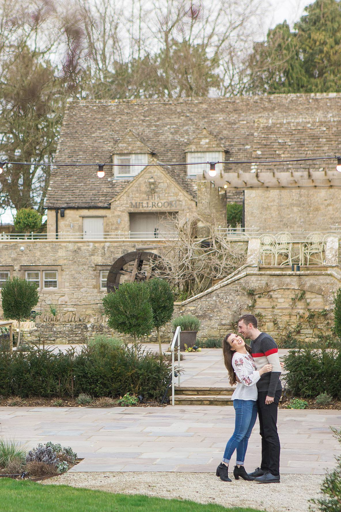 frogmill couple laughing cheltenham engagement photographer
