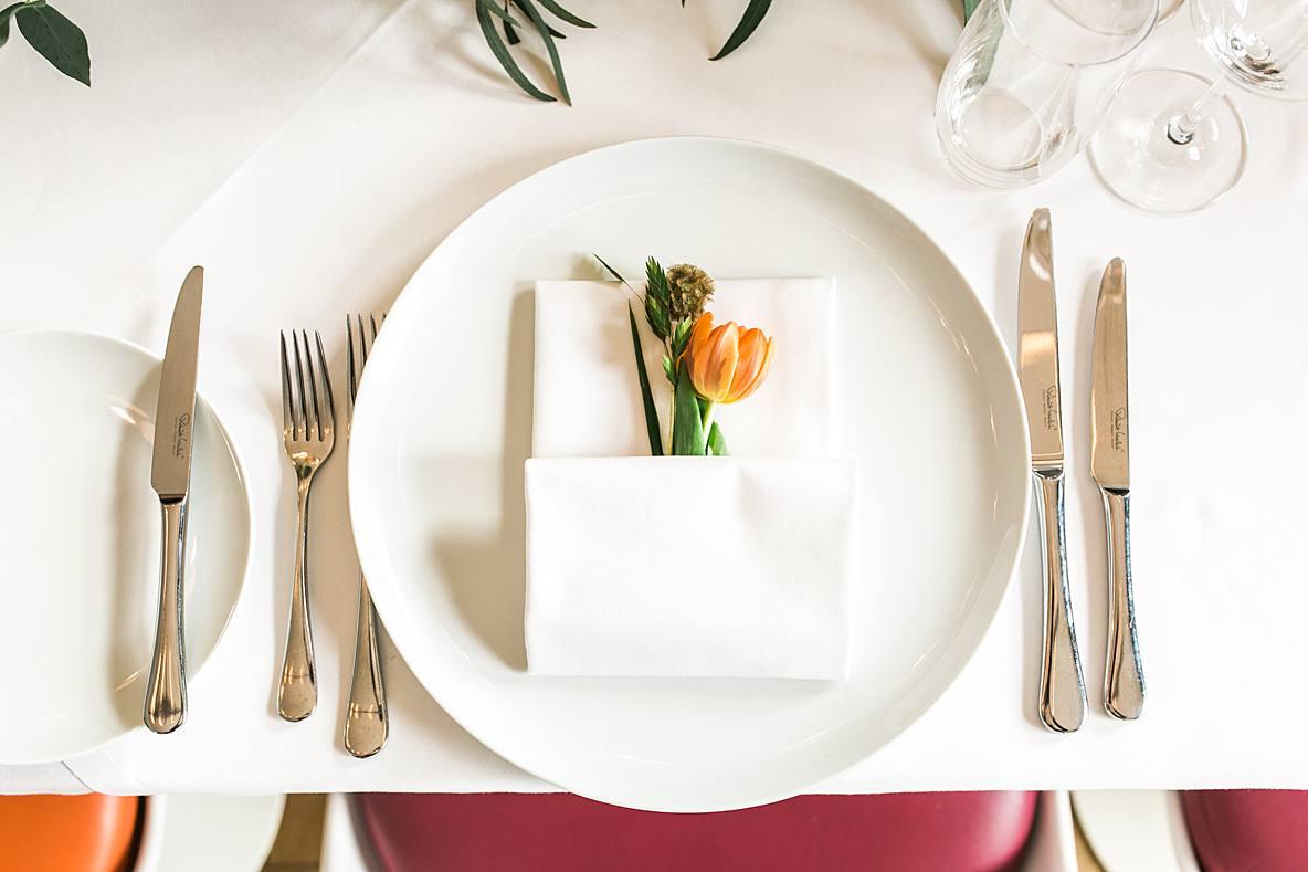 orange tulip on plate Cowley Manor hotel wedding