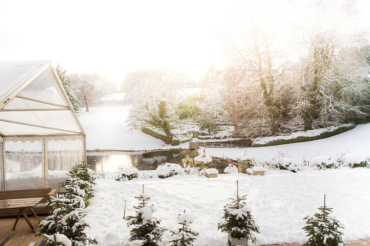 Cowley Manor marquee in snow scene wedding day