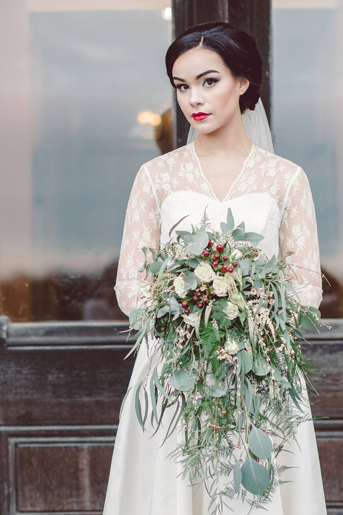 winter bride with bouquet at Grittleton house