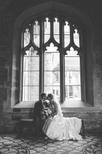 Tortworth court bride and groom kissing for wedding photographer