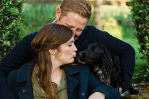 lady kissing dog engagement shoot with Gloucestershire wedding photographer