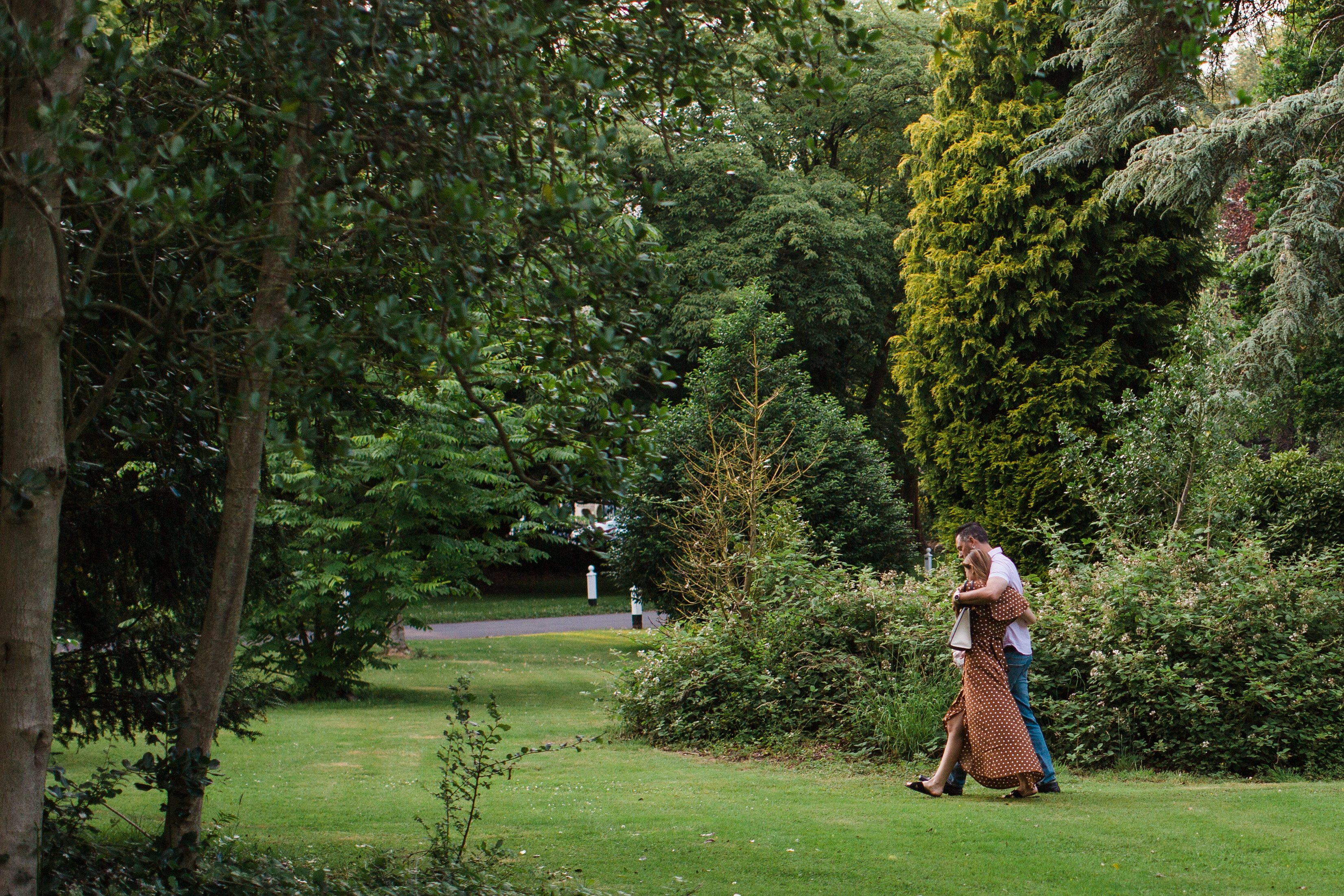 couple walking in Tortworth court garden Gloucestershire photographer