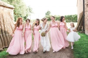 bridal party walking together laughing Bristol photography wedding