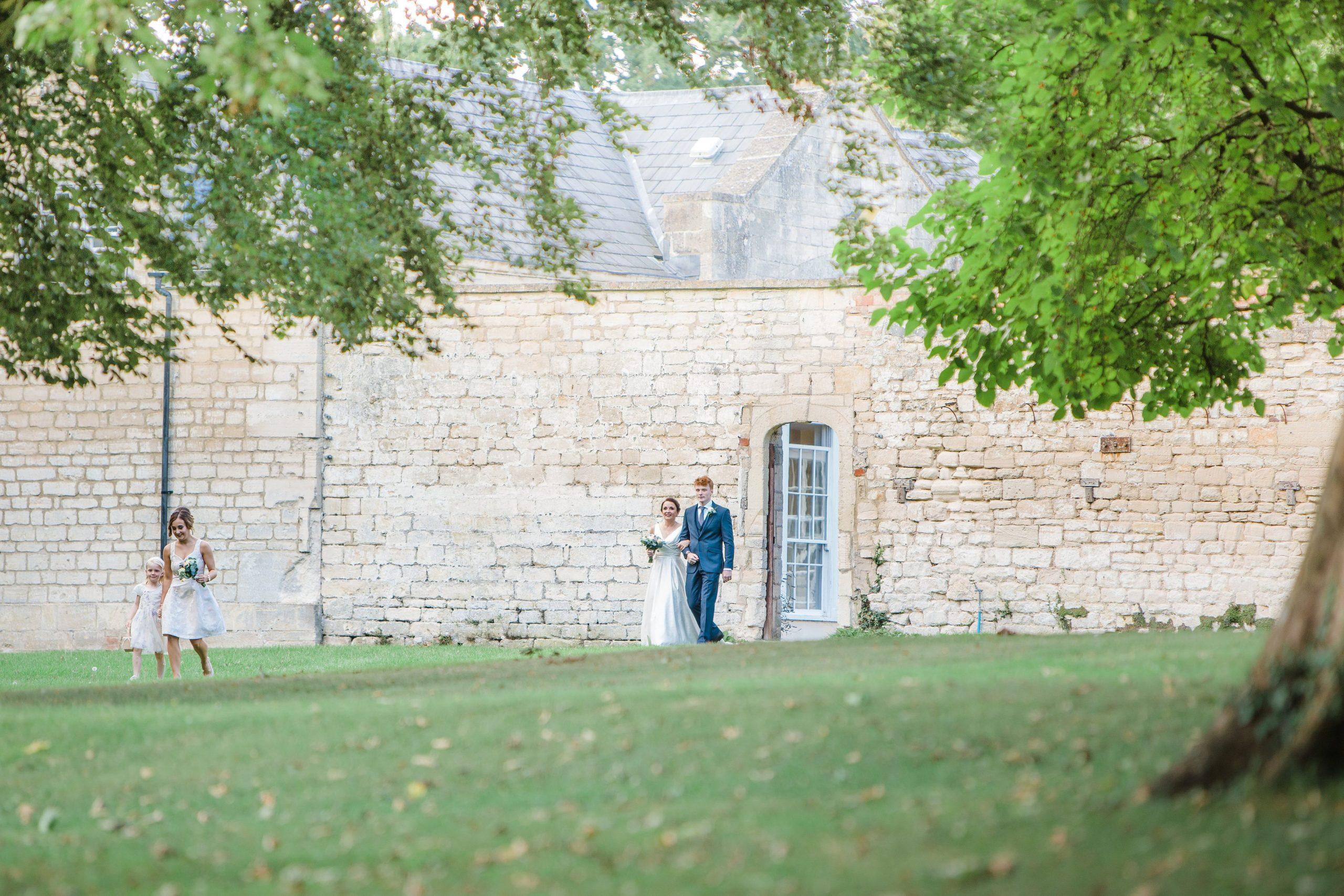 bride walking down to outdoor ceremony wedding eastington park