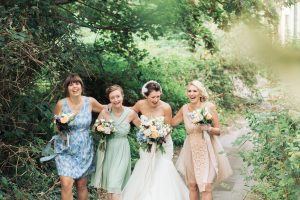 bride and bridesmaids wedding portrait laughing