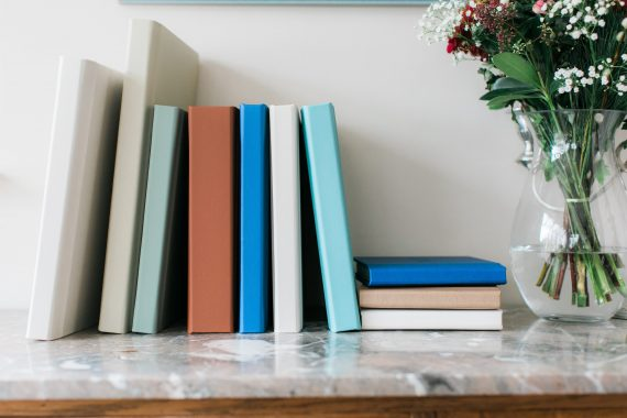 leather albums sizes left to right (12x12, 14x10, 10x10, 6x6)
