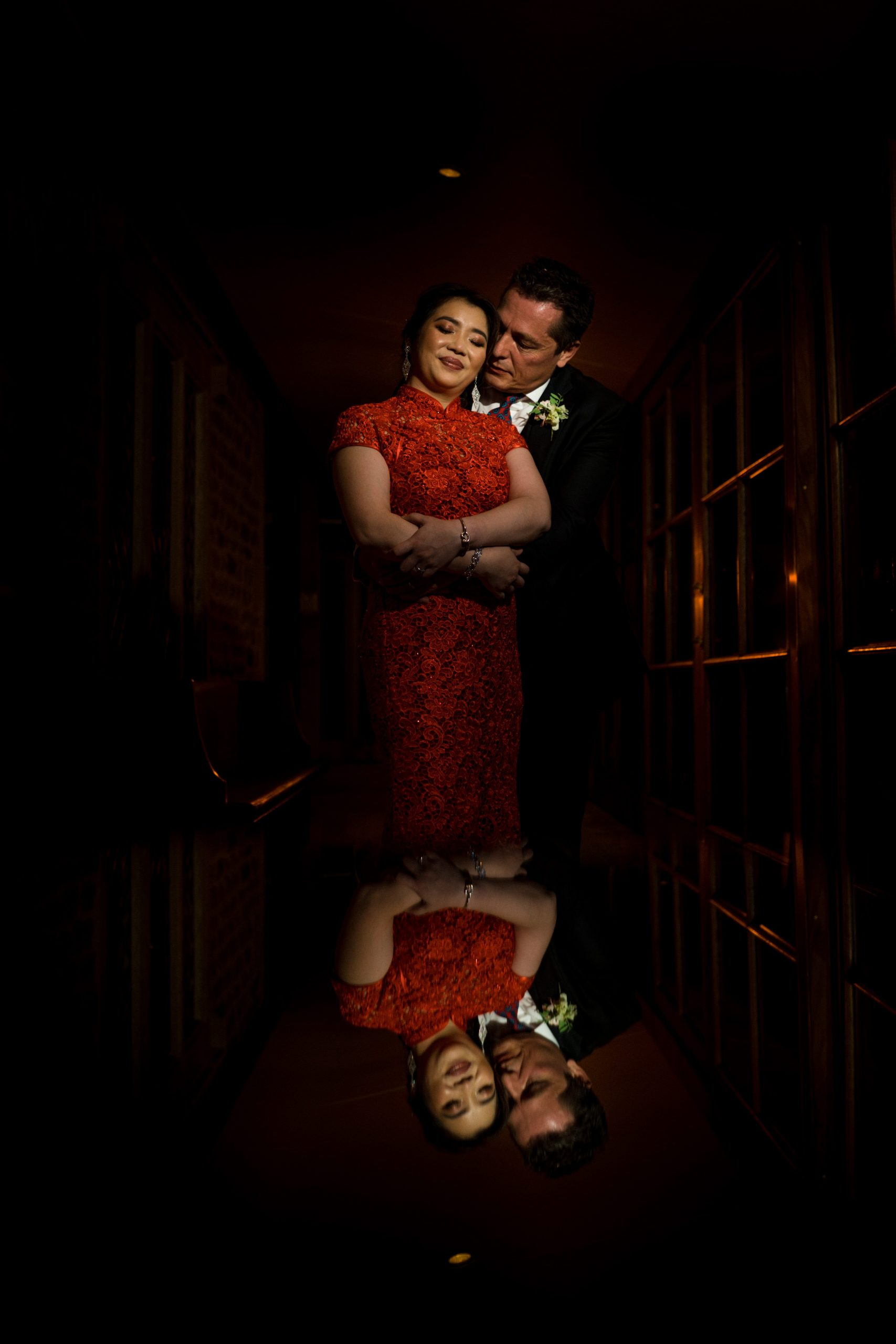 couple hug in dark corridor for bowood wedding photographer