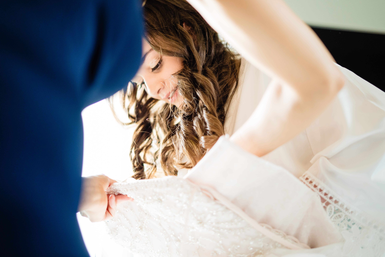 bowood bride putting on wedding dress wiltshire photographer