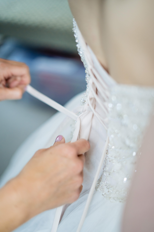 lacing up wedding dress wedding photographer
