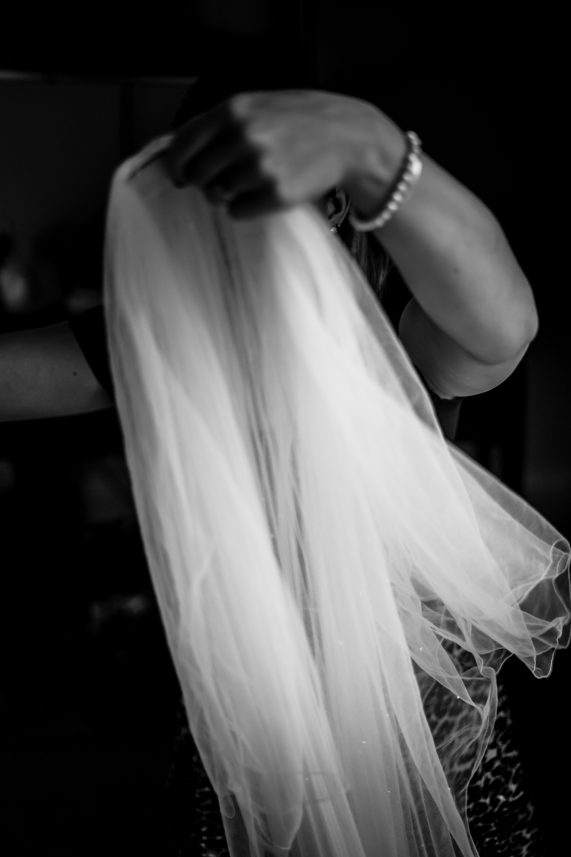 putting on veil wedding photographer bowood hotel golf and spa