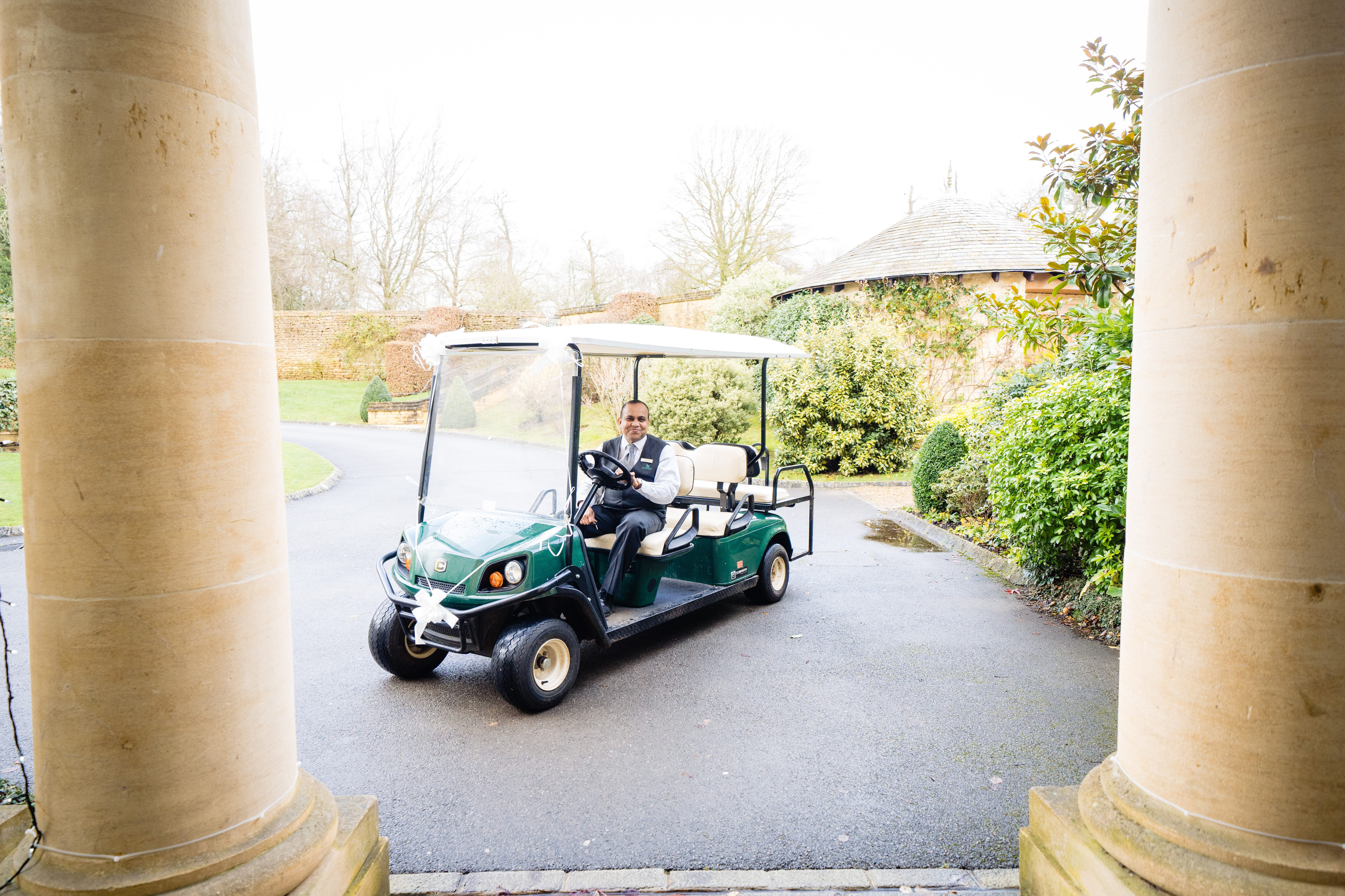 golf cart provide transportation to bride at bowood wiltshire wedding photographer