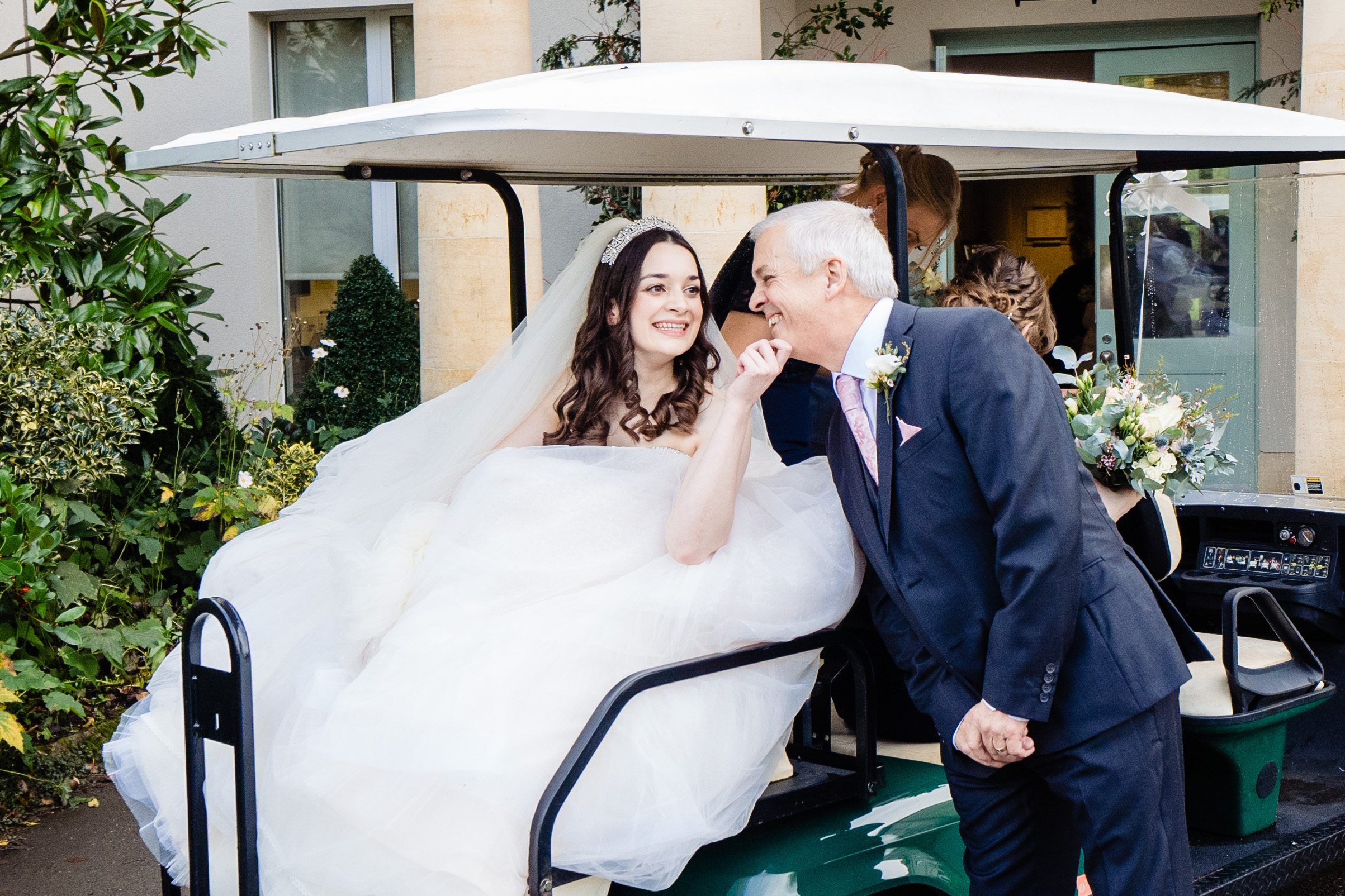 bride and dad with golf cart bowood hotel