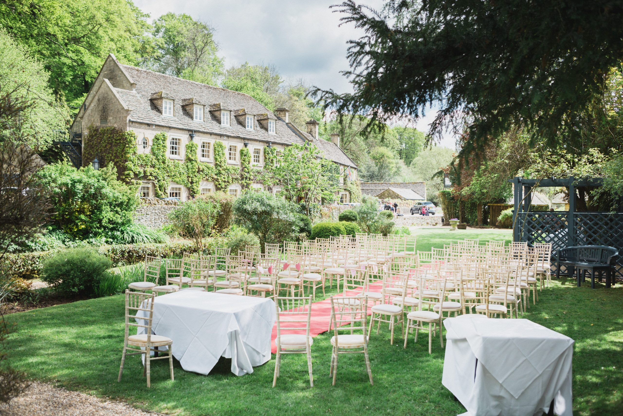 outdoor ceremony area the swan Bibury gloucestershire wedding photographer