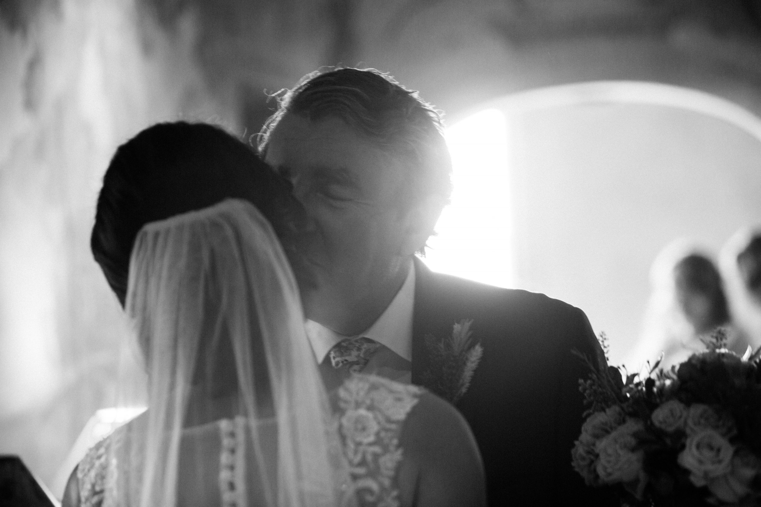dad kissing bride Gloucestershire wedding photographer