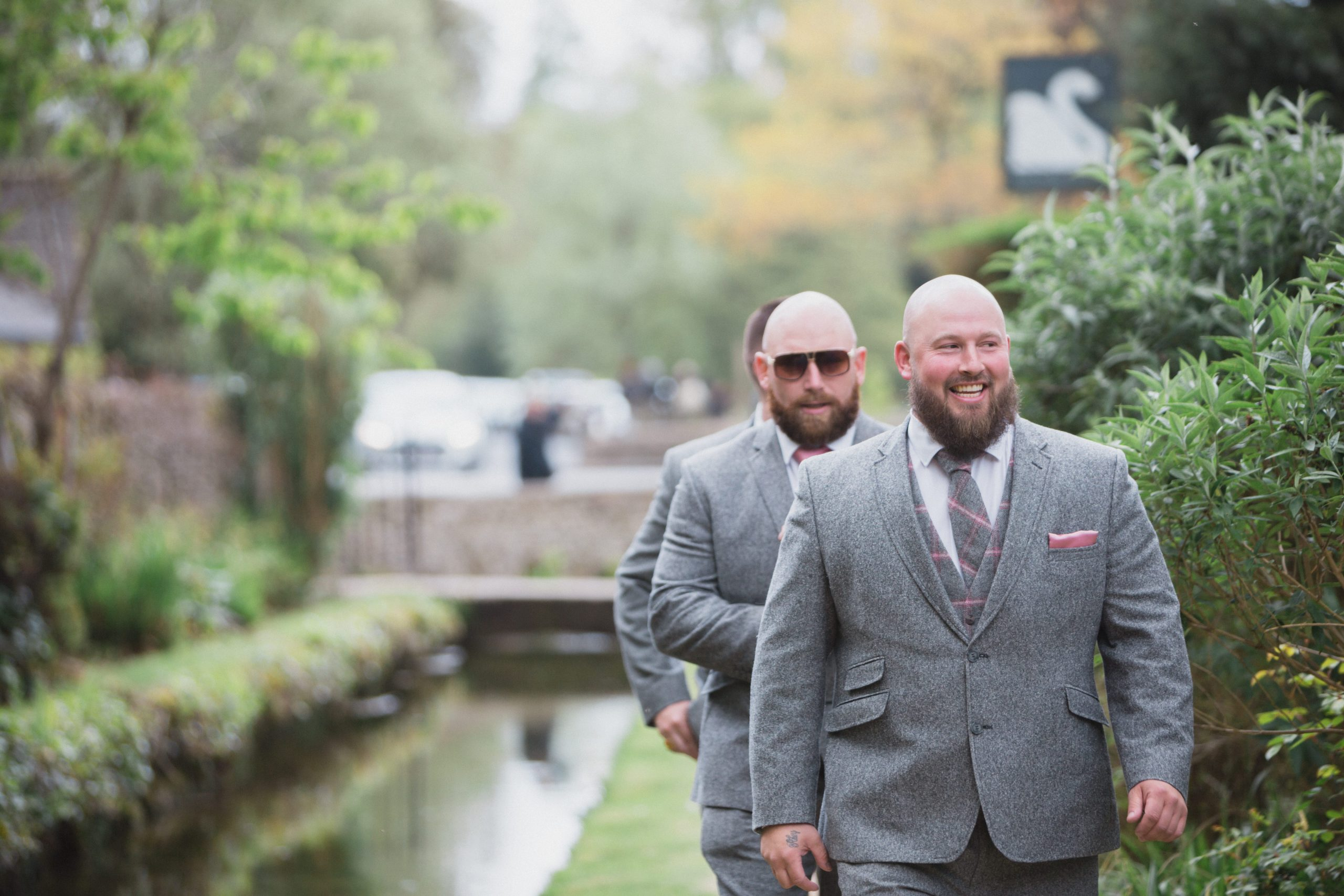 groom walking to ceremony Bibury wedding photographer