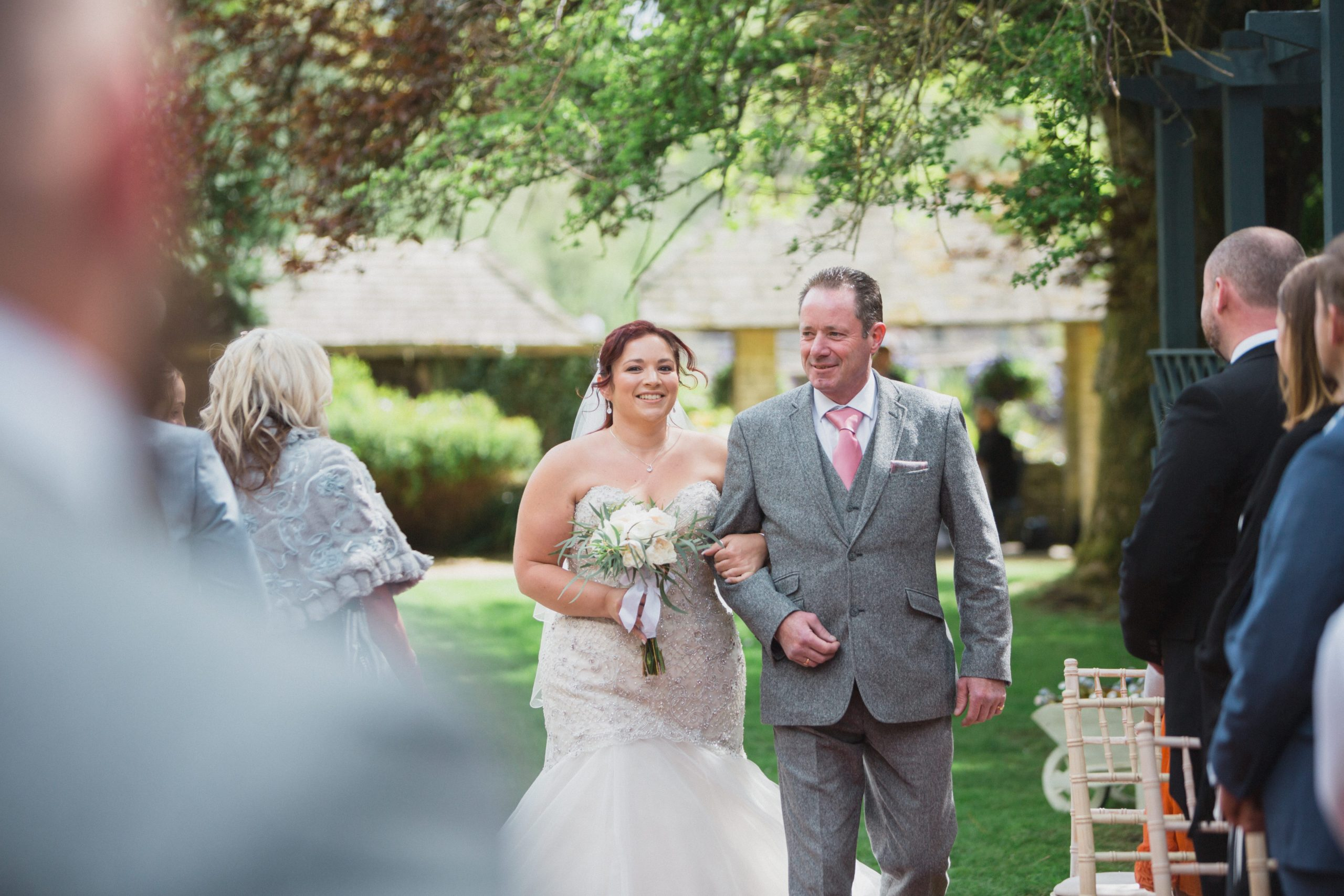 bride walking down aisle outdoor ceremony cotswold
