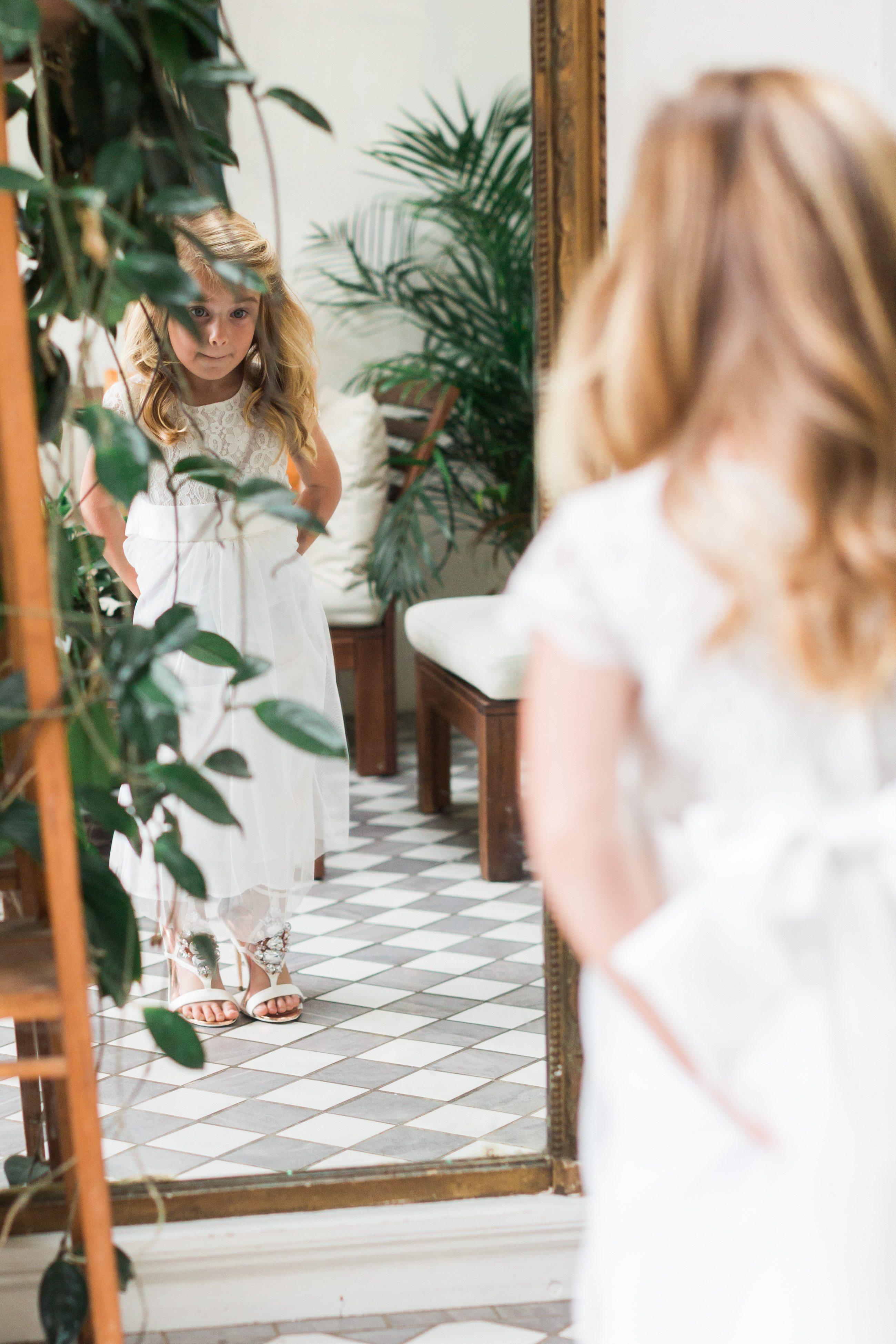 little girl wearing brides wedding shoes for gloucestershire wedding photographer