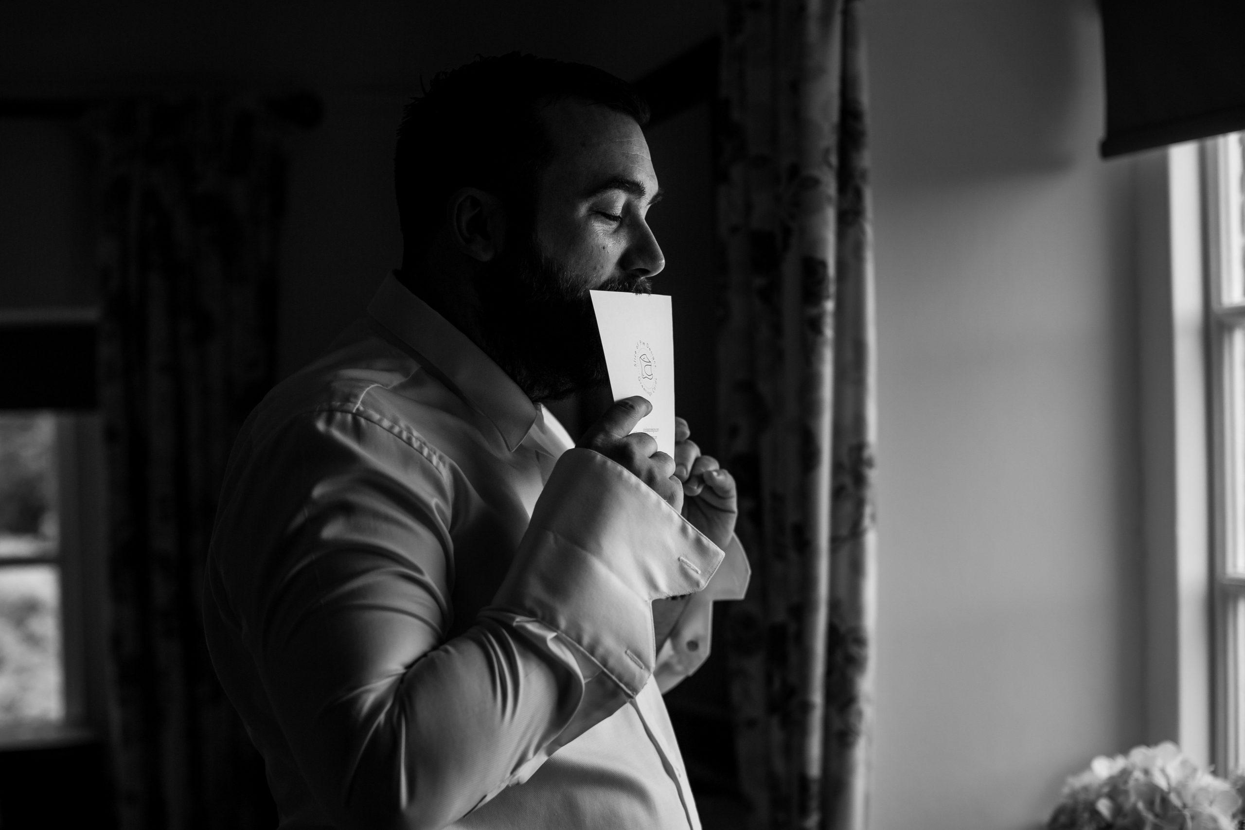 groom kisses card from bride uk wedding photographer