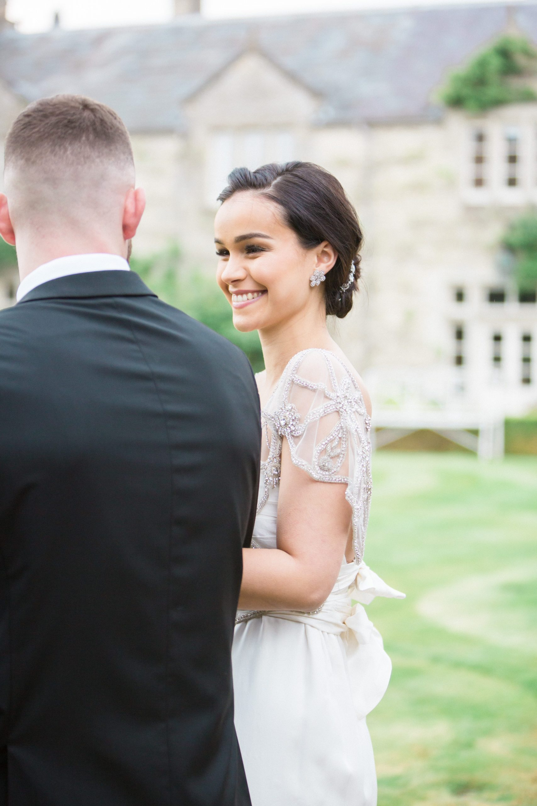bride smiling with groom the lost orangery