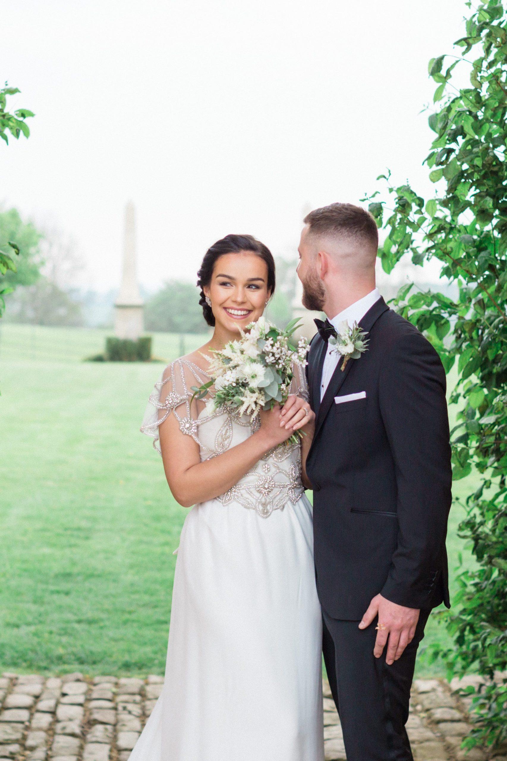 bride and groom smiling Euridge Manor may wedding