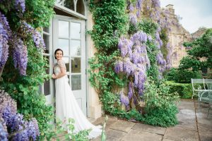 bride in dress by wisteria Euridge Manor may wedding