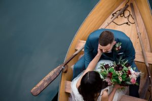 couple in boat at Euridge Manor and orangery for wedding photographer