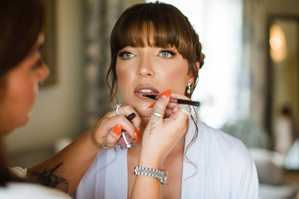 bride lipstick being applied cheltenham wedding